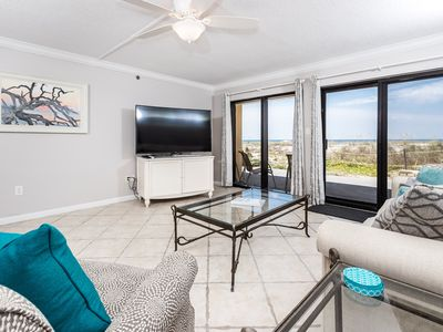 """Photo for """"Surf Dweller Unit 112"""" Newly Remodeled, 65 Inch Curved HD TV, Gulf Front, Steps to the Beach! Bea"""