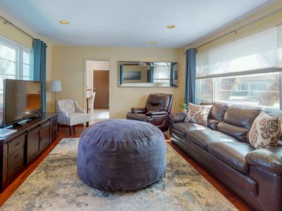Photo for NEW LISTING! House with private hot tub & Ping-Pong - 1.5 miles to the beach!