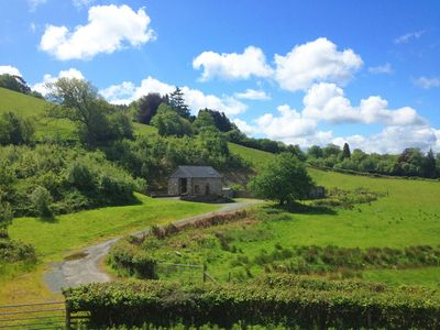 Photo for Part of a working organic farm Beudy Clygo is a cosy converted barn nestled in a secluded hillside w