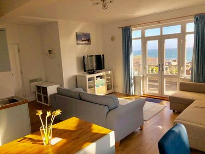 Lounge  with outstanding Views over St Ives opening onto Terrace