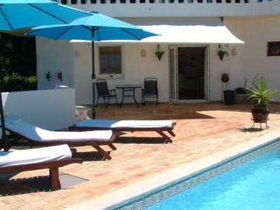 Exclusive pool side apartment high in the hills above Loule.