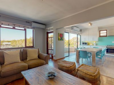 Photo for Warm, vibrant, & welcoming getaway w/ a full kitchen & furnished balcony