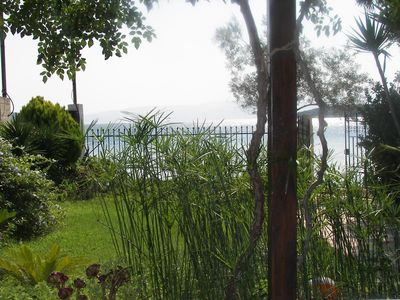 Photo for Beach-front stylish Cottage in Evia island, 2metres from the beach.