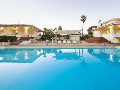 Photo for 9 bedroom Villa, sleeps 18 with Air Con, FREE WiFi and Walk to Beach & Shops