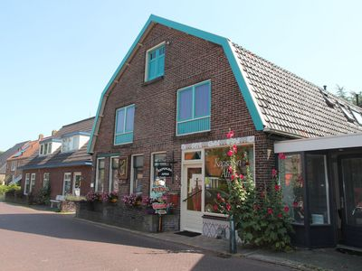 Photo for Lovely holiday home with garden in the centre of Egmond-Binnen