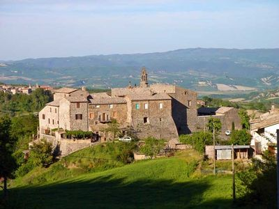 The walled hamlet of Benano. In this view, Rocca di Benano is on the left side.