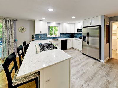 Kitchen - Inviting kitchen with stainless steel appliances and white quartz counters.