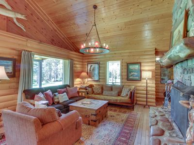 Photo for Riverfront getaway w/ spacious deck, dock, and firepit! On 16 acres!
