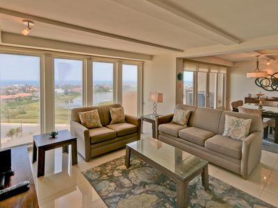 Photo for Gorgeous view to the bay! Spacious condo in beachfront resort, shared pools & jacuzzi Dog friendly