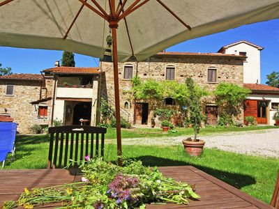Photo for Apartment in rustic house with garden, near medieval hamlets