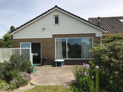 Photo for detached house garden overlooking the dunes, near the village center and beach