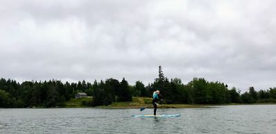 paddle boarding in front of the cottage 1.6 miles of pristine cove
