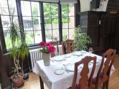 The dining area is in the bay window, looking out onto the garden