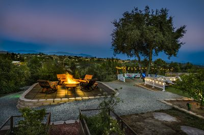Bonfire deck with Hammock Lounge in distance under oak tree with panoramic views
