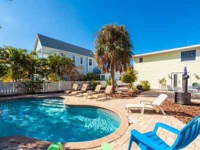 Perfect Island Location! Heated pool and plenty of room for the entire family.