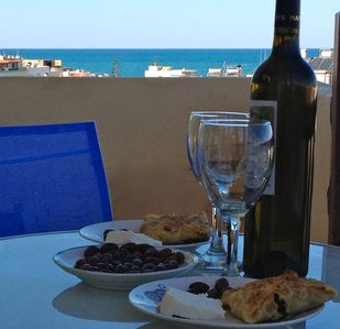 Appetizers on the balcony overlooking the Aegean sea.
