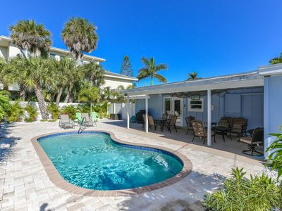 Photo for Adorable Siesta Key Home. Private Heated Pool. Amazing Back Yard. Close to Beach and Village. Ground Level. Walk Everywhere! Personal Property Manager Included.