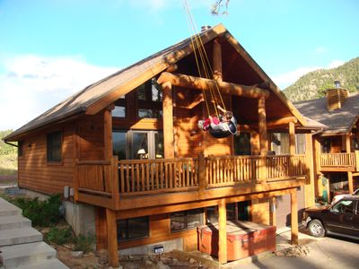 Photo for Luxury Cabin 4bdr mountain and river views.  Private Hot tub, 2 blocks to shops