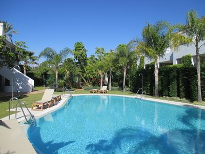 Photo for Tasteful apartment, small complex, large private terrace, pool,
