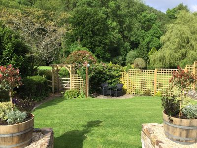 Photo for Peaceful wooded valley close to Exmoor. Luxury Lodge perfect for two.
