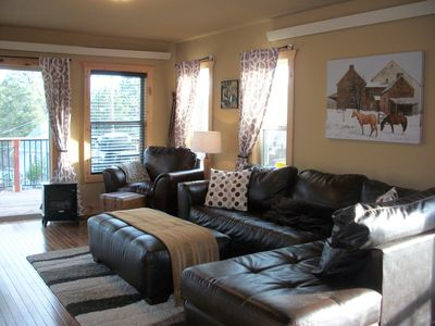 Living room. Leather couch, chair & ottoman.