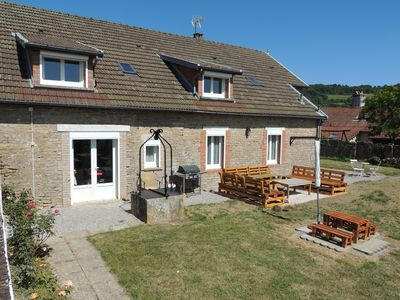 garden with outside seating, barbecue and two big picnic tables for 10 people