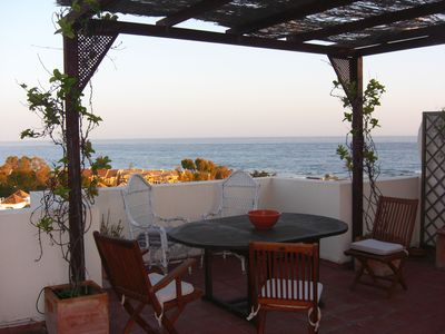 Photo for Penthouse in front of the beach with fantastic terrace , wifi, parking and pool