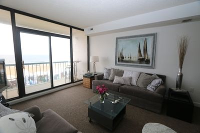 Living Room - Enjoy gorgeous ocean views through these floor to ceiling windows or take in the ocean air out on the private balcony. This living space contains a Queen sized sleeper sofa for additional guests.