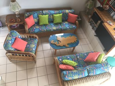Living room with unique coffee table map of STJ