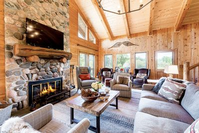 Living Room - A river rock wood-burning fireplace is the focus of the spacious living room