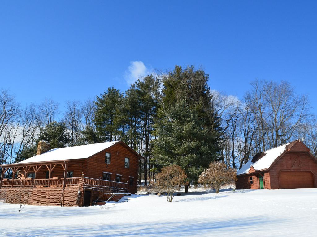 Large log cabin on 12 private acres with homeaway butler for Private fishing ponds near me