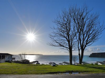 Photo for Beachside caravan with open sea views a beautiful Lydstep Bay Holiday Park.