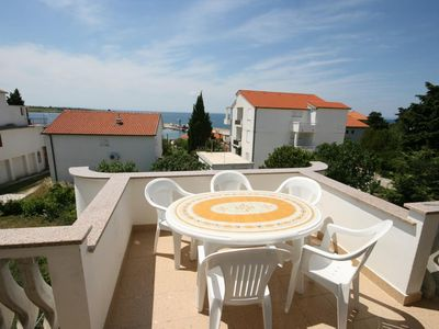 Photo for Two bedroom apartment with terrace and sea view Novalja, Pag (A-6583-b)