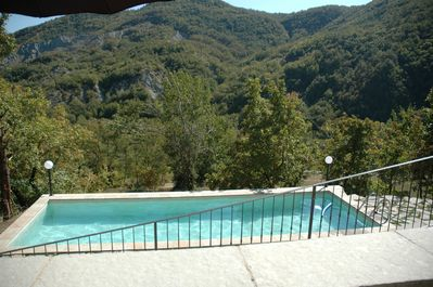 The lovely shared pool has gorgeous mountain views