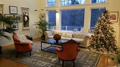 Beautiful decor with floor to ceiling windows.