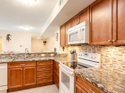 Photo for Gorgeous condo within minutes to Shopping and Restaurants