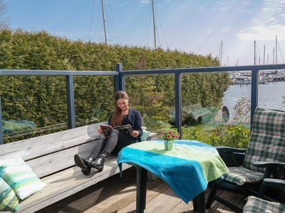 Photo for 4 pers. Holiday home Zeemeeuw with own fishing pier in front of the Lauwersmeer