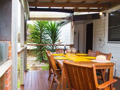 elevated back deck- gas BBQ seating for 6 and adjustable weather shield blinds.