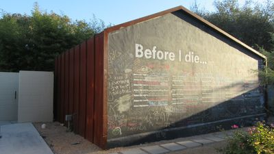 The exterior south wall of the Art Barn.  A living art installation!