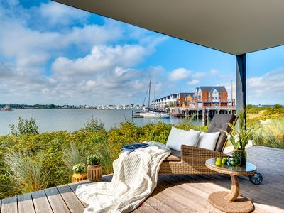 Photo for Dreamlike luxury holiday apartment directly on the water with sun terrace, sauna, fireplace