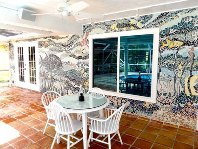 Outdoor dining table by the handmade mosaic