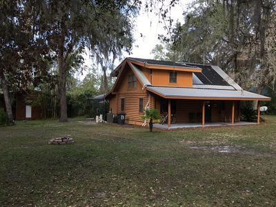 Photo for Lakefront Log Home, Screened Solar Water Heated Pool, Hot Tub & Recreation House