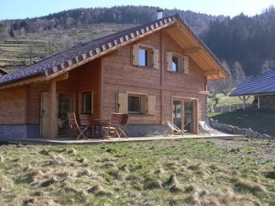 Photo for Charming chalet located at the edge of a pond with views of the ski slopes