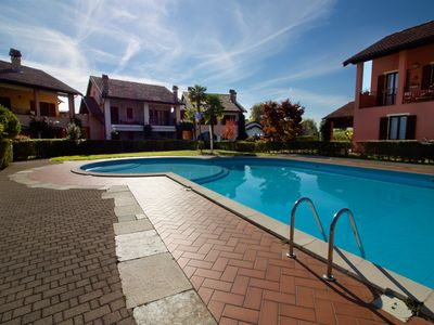 Photo for 4 bedroom Apartment, sleeps 7 with Pool, FREE WiFi and Walk to Beach & Shops