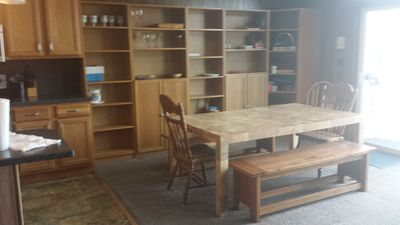 Wall of storage space and large dining room table