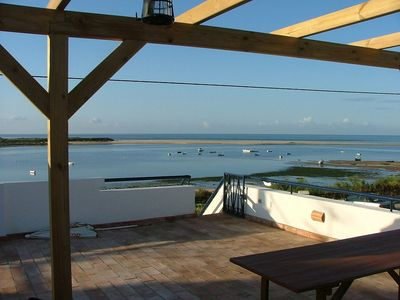 Photo for Beautiful cottage right next to the sea. Peaceful location, Ria Formosa Reserve