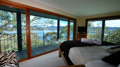 King size island bed - views to die for -day and night