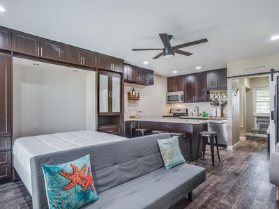 Photo for Updated, modern condo w/ a shared pool, BBQ area, & gas grill - near beach!