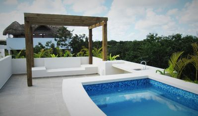Photo for Beautiful Jungle 3Bedroom Condo with Rooftop Pool/ Bikes