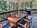 Enjoy our 360 wraparound deck with dining table, bbq, hammock and agas fireplace